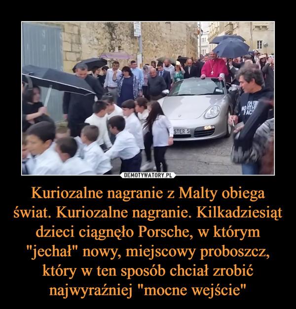 """Kuriozalne nagranie z Malty obiega świat. Kuriozalne nagranie. Kilkadziesiąt dzieci ciągnęło Porsche, w którym """"jechał"""" nowy, miejscowy proboszcz, który w ten sposób chciał zrobić najwyraźniej """"mocne wejście"""" –"""